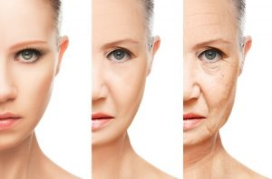 27323350 - concept of aging and skin care. face of young woman and an old woman with wrinkles isolated